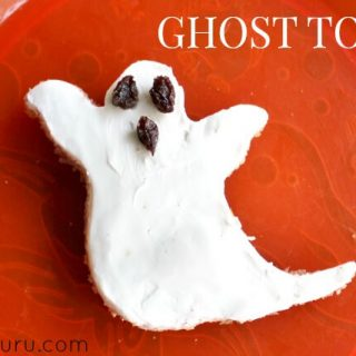 Ghost Toast, cream cheese on ghost shaped toast with raisins for the eyes and mouth
