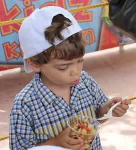 There were a lot of giveaways and food samples.  in the picture Max was gobbing up a fresh salad he made at the Baptist Health tent.  Other giveaways included pasta, pizza, frozen yogurt, green smoothies, bananas, coconut water, cheese and all sorts of pencils, coloring books, stickers and soccer balls.  I was loaded up like a mule by the end of the day.