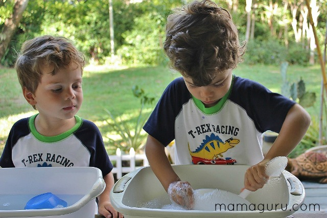 2 little boys wash dishes outside for preschool fun