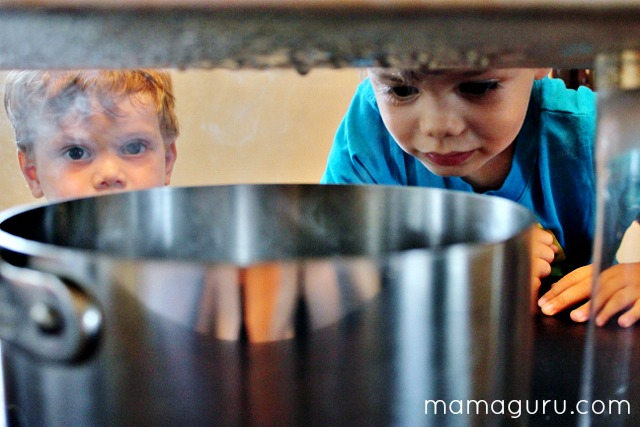Homeschool science lesson: 2 children make a cloud inside using ice and boiling water.