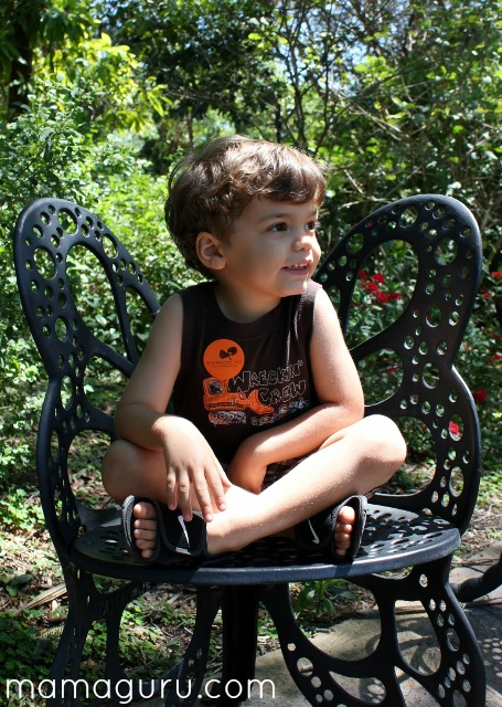 Child sitting on a butterfly chair at Fairchild Tropical Gardens in Miami