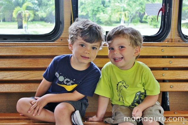 Fun summer activity: 2 kids ride on a trolley