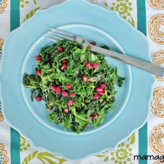 Kale cooked with lemon and garlic and garnished with raisins or pomegranate seeds