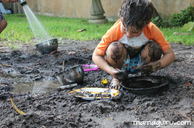 Little boys play in mud and get messy at Mud Day for Kids